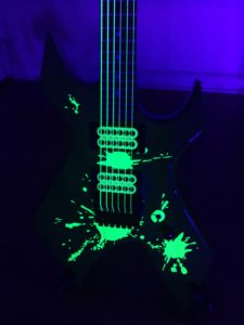 Close up Guitar with Vinyl Splats Applied Black Light 2`
