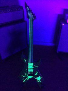 Guitar with Vinyl Splats Applied Black Light