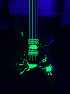 Close up Guitar with Vinyl Splats Applied Black Light